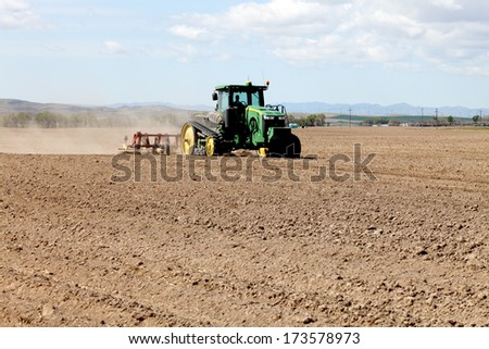 American Falls, Idaho,  Apr. 11, 2012 Image of a tractor plowing a field in preparation for planting wheat.