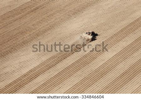 American Falls, Idaho, USA Apr. 17, 2015 An aerial view of farm machinery planting potatoes in the fertile farm fields of Idaho. - stock photo