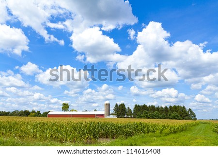 American Farm With Cloudy Sky - stock photo