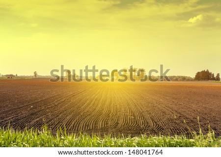 American Farmland at sunset - stock photo