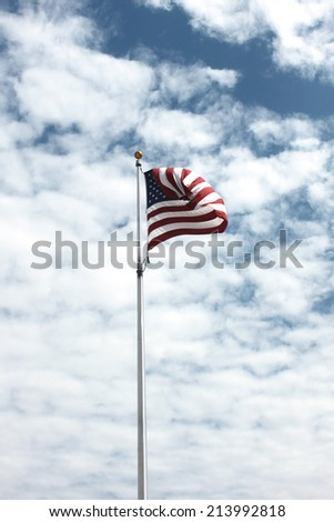 American flag against cloudy sky - stock photo