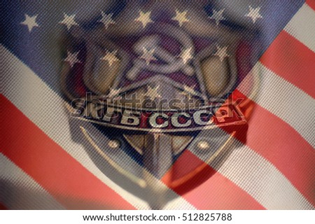 American flag and Coat of arms of the state security Committee of the USSR (KGB)