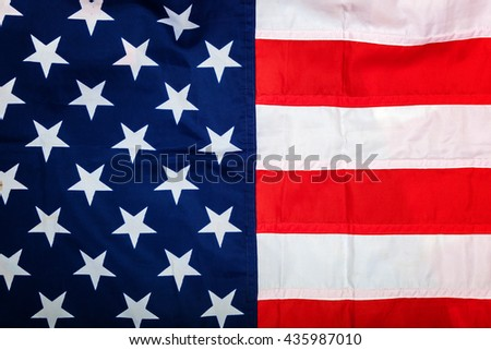 American flag as a backdrop. - stock photo
