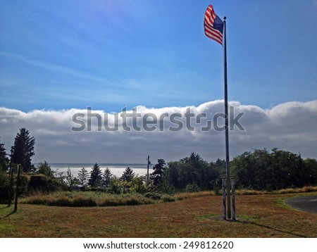 American Flag at Fort Columbia State Park Washington USA Overlooking Columbia River - stock photo