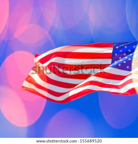 American flag at sunny day with flare  - stock photo