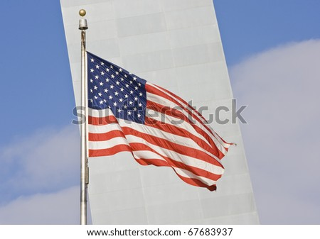 American flag background with Gateway arch in back - stock photo