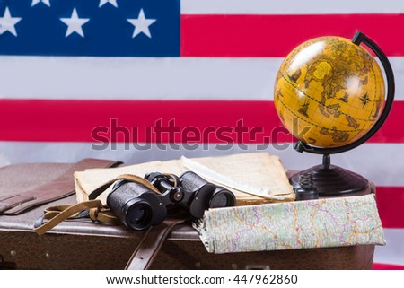 American flag behind globe. Binoculars with book and feather. We wrote our own history. Journey through the history's pages. - stock photo
