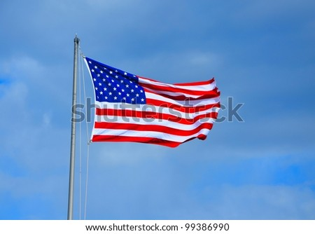 American flag blowing in the breeze on a summer day - stock photo