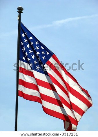 American flag blowing in wind - stock photo