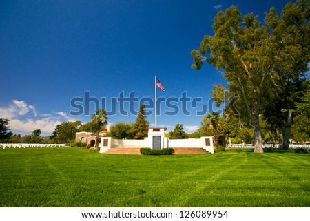 American flag flies high over Los Angeles National Cemetery. - stock photo