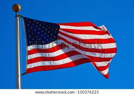 American flag flying on a beautiful clear day