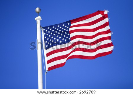 American flag flying over a blue background