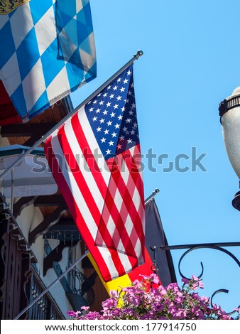 American Flag Hanging from the Side of Storefront in Leavenworth WA USA - stock photo