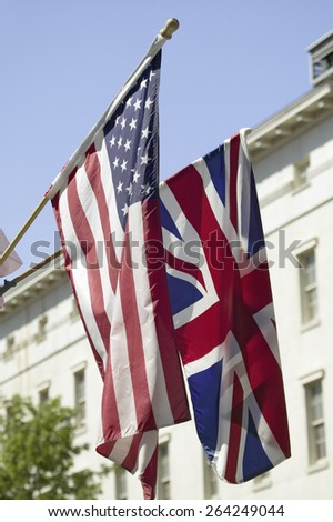 American Flag hanging with Union Jack British Flag next to the White House, Washington, DC, symbolizing the Special Relationship between England and America. - stock photo