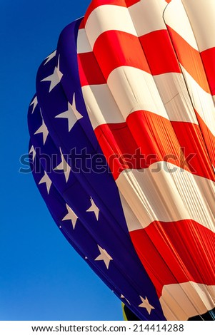 American flag hot air balloon getting inflated before take off - stock photo