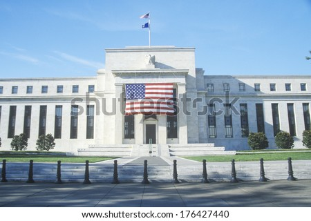 American Flag hung on The Federal Reserve Bank, Washington, D.C. - stock photo