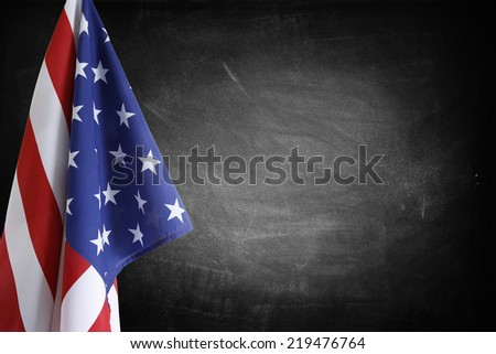 American flag in front of blackboard - stock photo
