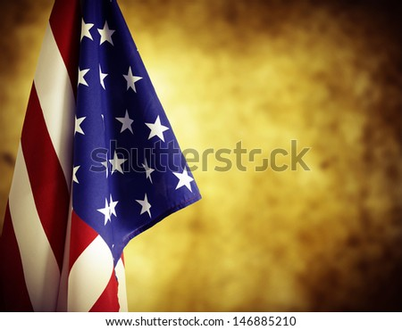 American flag in front of blurred background. Advertising space - stock photo