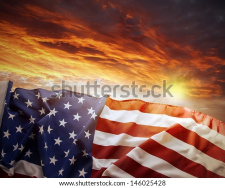 American flag in front of bright sky - stock photo