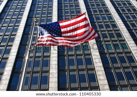 American flag in front of business building - stock photo