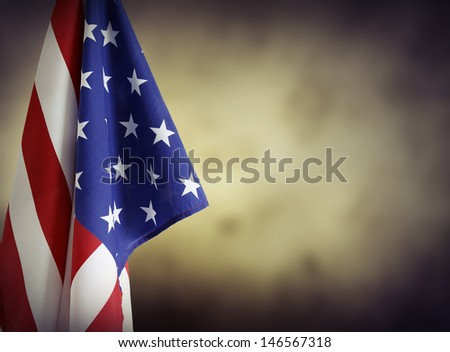 American flag in front of plain background. Advertising space - stock photo