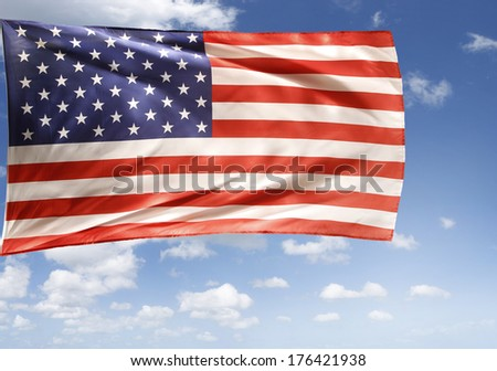 American flag in front of sky - stock photo
