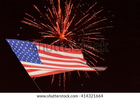 American Flag is flying and fireworks. - stock photo