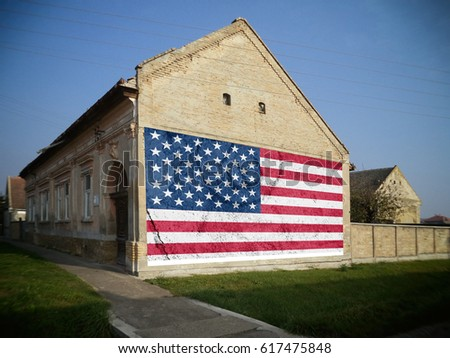 American Flag On An Old Farmhouse Blurred Image