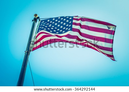American flag on blue sky ( Filtered image processed vintage effect. ) - stock photo