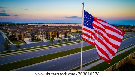 American flag on flag pole above stock photo 703810576 shutterstock american flag on flag pole above american suburb during colorful sunset aerial drone view close to sciox Image collections