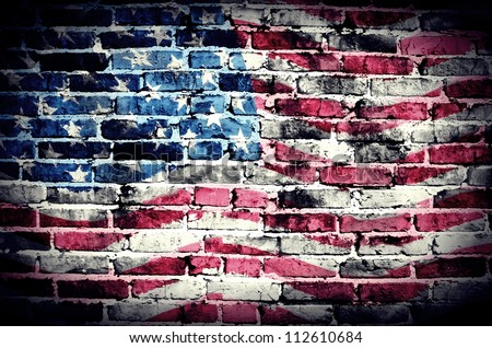 American flag on old brick wall Texture or background - stock photo