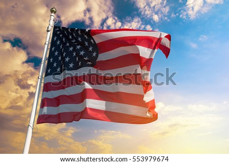 American flag on the background of beautiful sunset sky