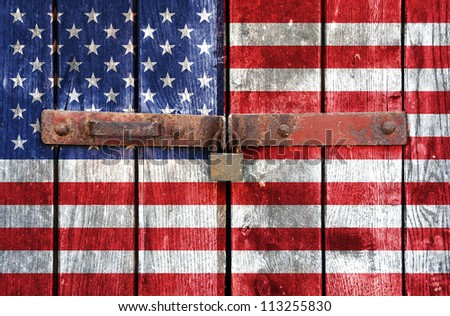 American flag on the background of old locked doors - stock photo