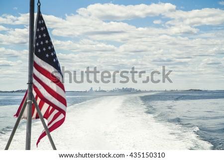 American flag on the boat leaving Boston harbor - stock photo