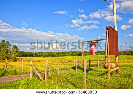 American flag on the gate of farm - stock photo