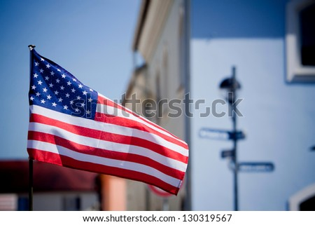American flag on the historic square