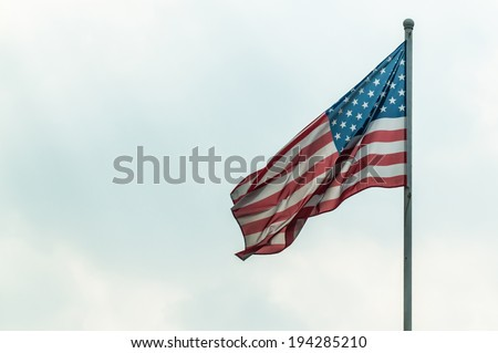 American flag on the sky background - stock photo
