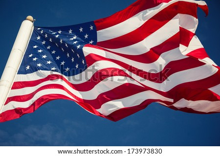 American flag over blue sky background
