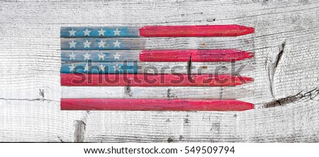 American flag painted on rustic old white washed wooden background. Visible texture, grain and knots. Concept for July Fourth, Independence Day, Memorial Day, Veterans Day or other patriotic occasion.