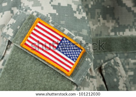 American flag patch on U.S. military combat uniform. - stock photo