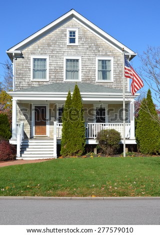 American flag pole Beautiful Gable style Suburban Home Sunny Autumn clear blue sky day residential neighborhood USA - stock photo