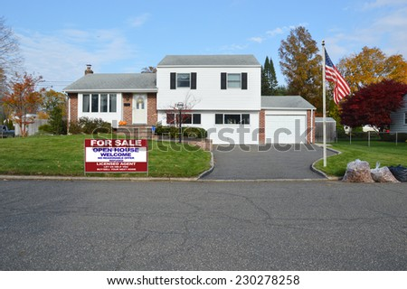 American flag pole for sale real estate sign on front yard for High ranch house