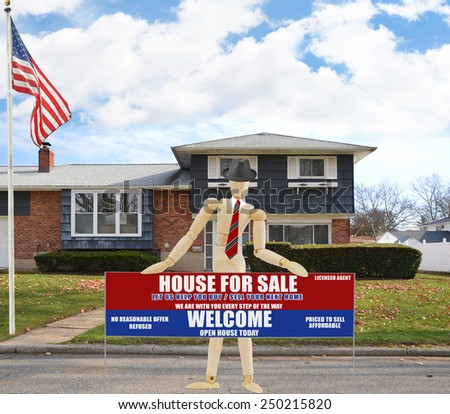 American flag pole mannequin holding Real estate for sale open house welcome sign Suburban high ranch brick home autumn blue sky clouds day residential neighborhood USA - stock photo