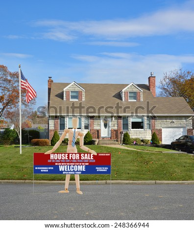 American flag pole Mannequin holding sign Real estate for sale open house welcome sign Suburban Cape Cod home landscaped beautiful autumn day residential neighborhood USA - stock photo