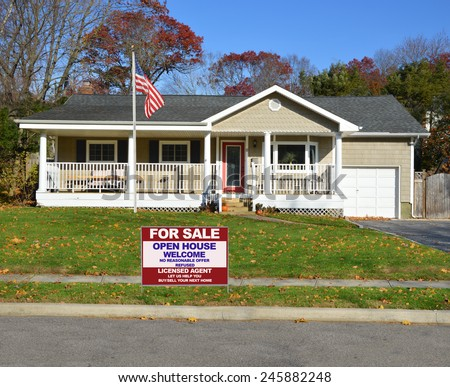 American flag pole Real estate for sale open house welcome sign Suburban Ranch style home with porch sunny autumn day residential neighborhood clear blue sky USA - stock photo