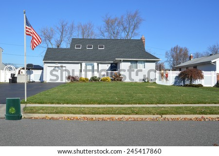 American flag pole recycle reuse reduce trash container Suburban home sunny autumn day residential neighborhood USA - stock photo