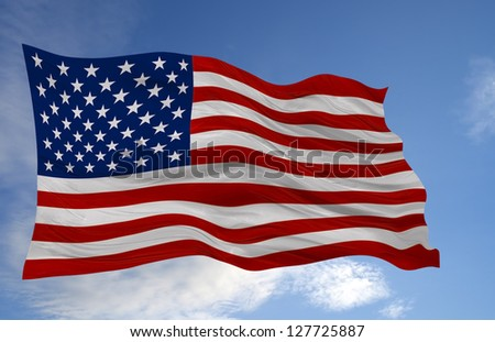 American flag waving against a cloudy sky