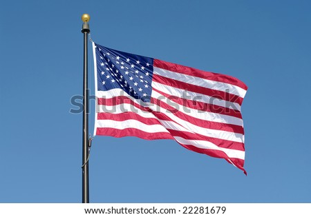 American flag waving against blue sky. See more flag images in my portfolio.