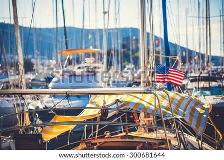 American flag waving from a sailboat off the coast of Maine, USA - stock photo
