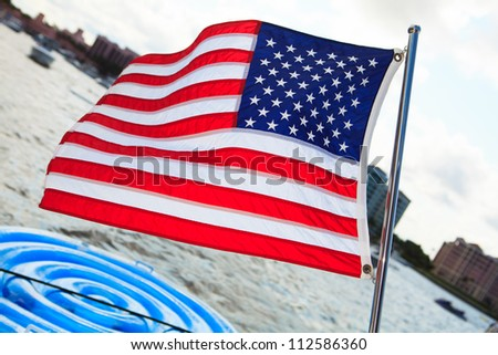 American flag waving from a yacht
